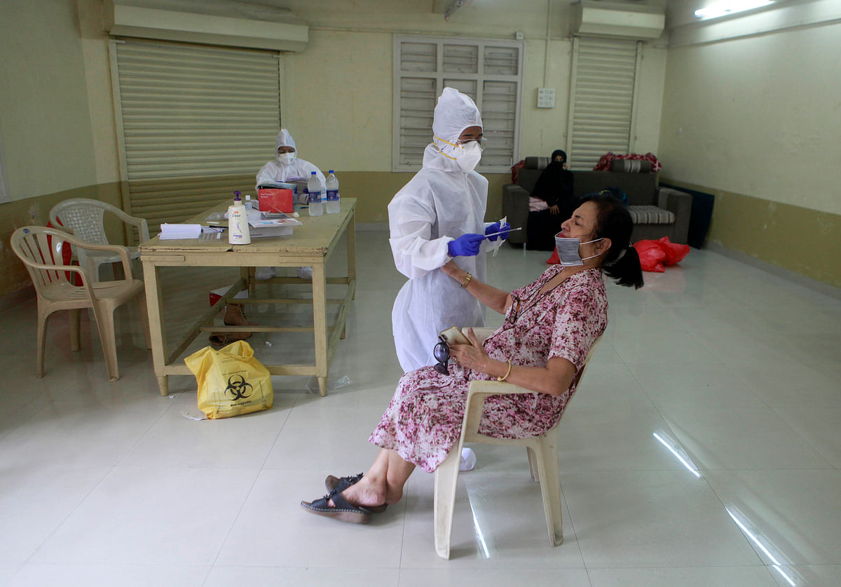 BMC Medical staff conducting rapid antigen test at Navjeevan society, Mahim(w) under BMCs Mission Zero, in Mumbai on Saturday