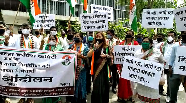 Congress workers protest against ban on onion export, in Pune on Wednesday.