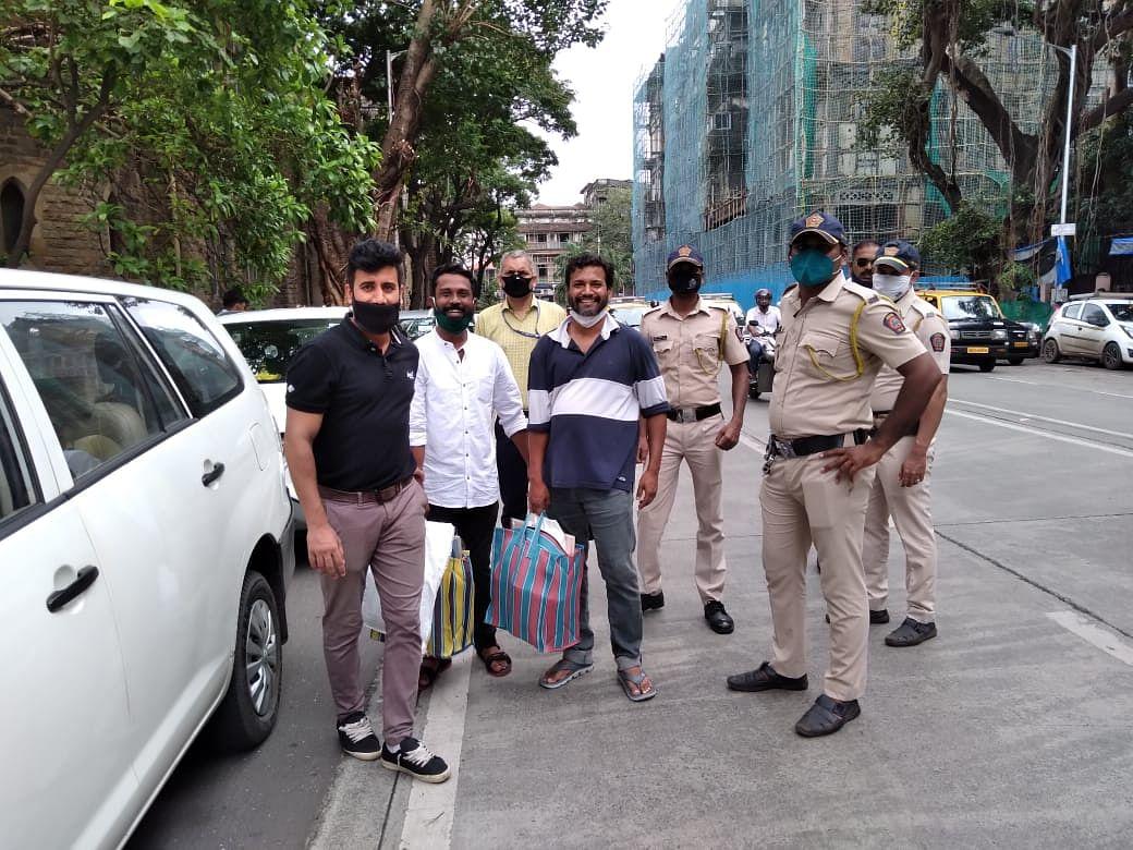 Sagar Gorkhe (second from left) and Ramesh Gaichor outside the court.