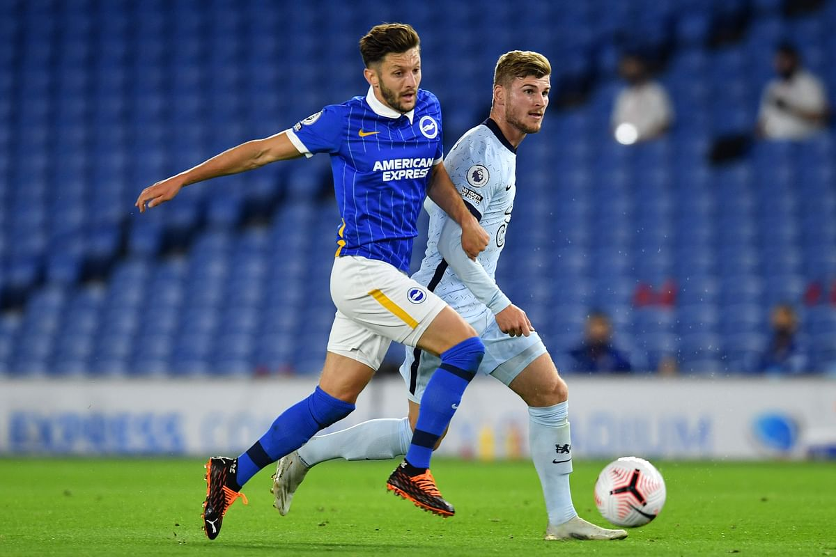 Brighton's English midfielder Adam Lallana (L) competes with Chelsea's German striker Timo Werner during the match on Monday