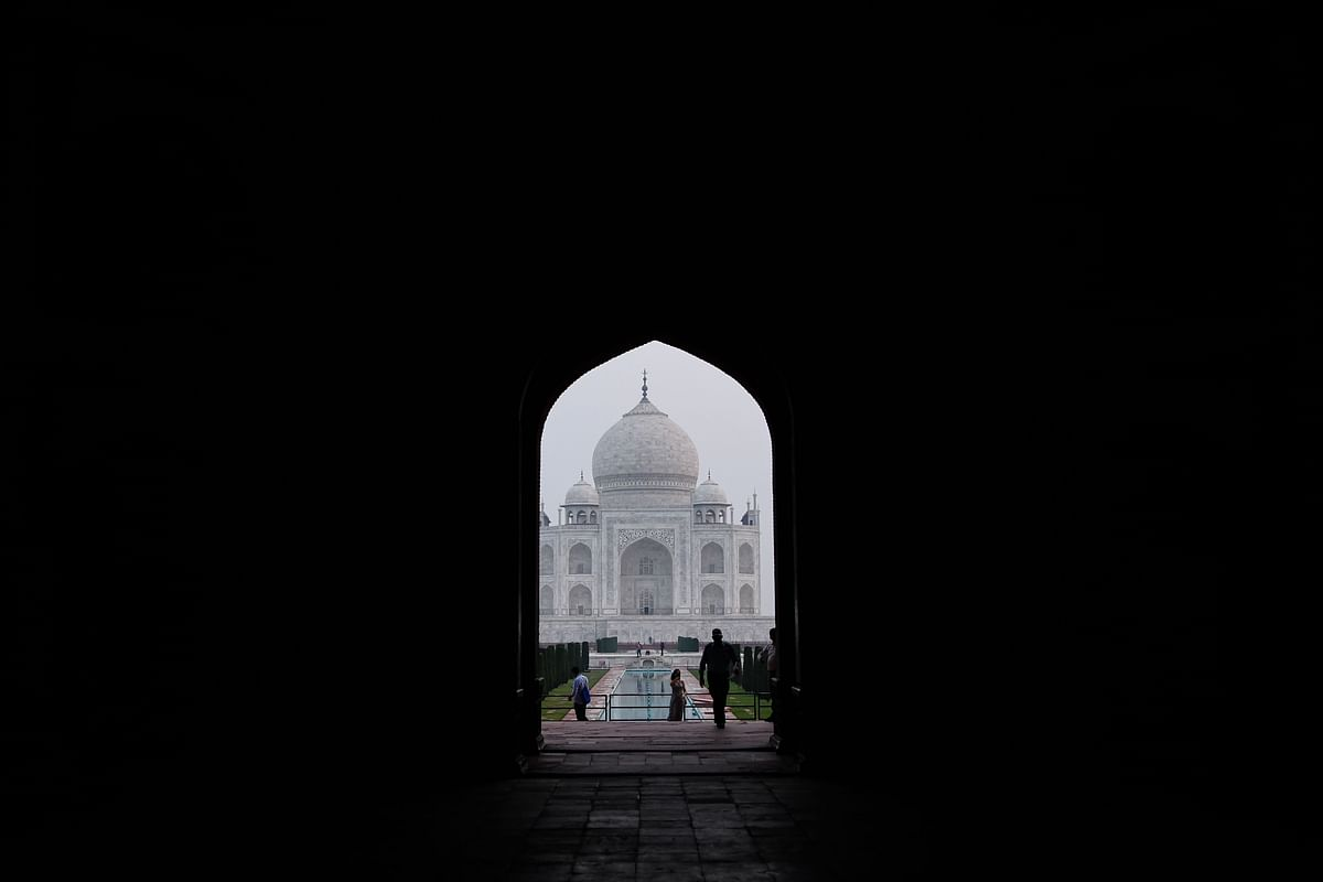 Tourists at the Taj Mahal in Agra on September 21, 2020. - The Taj Mahal reopens to visitors on September 21 in a symbolic business-as-usual gesture, even as India looks set to overtake the US as the global leader in coronavirus infections.