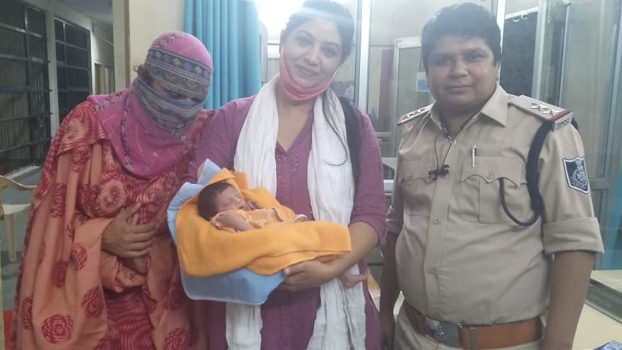 NGO director Bharti Mandole with the newborn after the child was rescued/ File pic