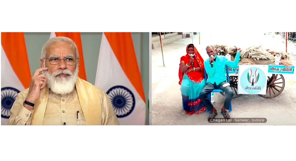 Prime Minister Narendra Modi holds Svanidhi Samvaad with street vendors from Madhya Pradesh through video conferencing, in New Delhi on Wednesday.