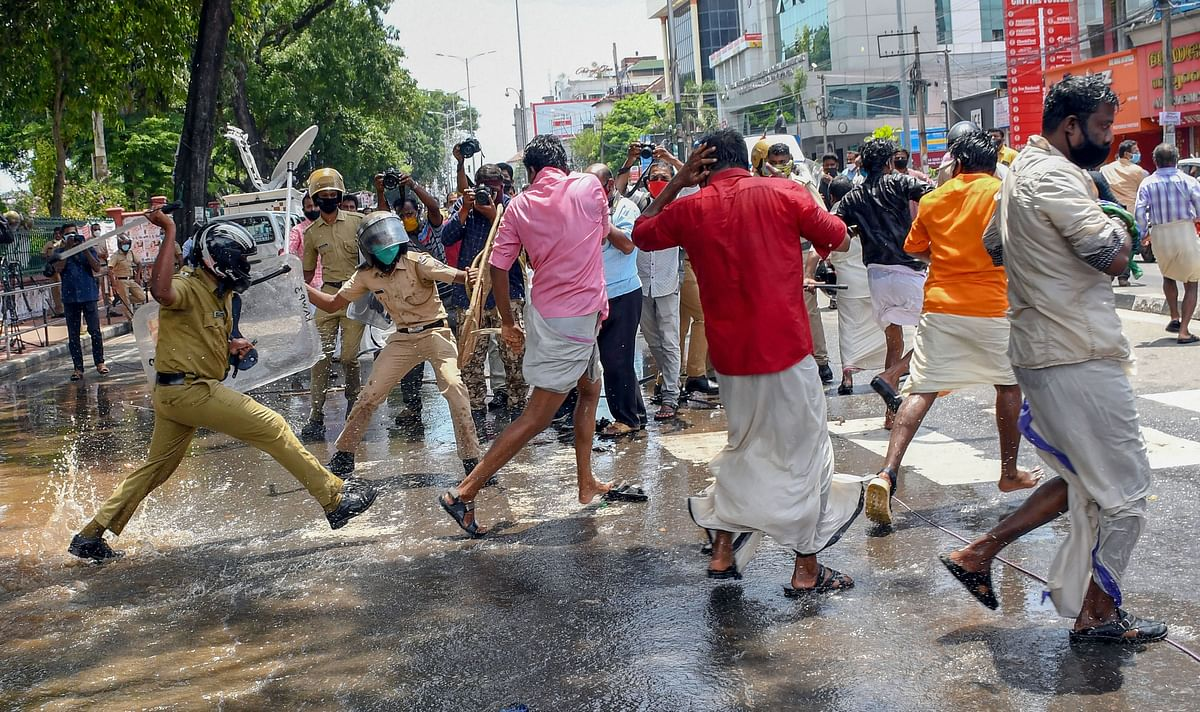 Police baton-charge BJP workers during a protest demanding resignation of Kerala Minister K T Jaleel.