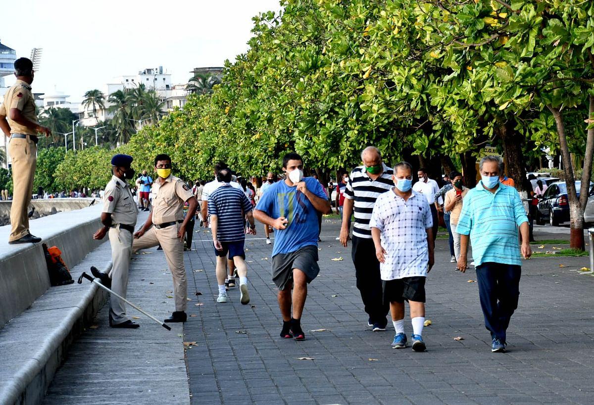 People take a stride sans mask at Marine Drive (File pic)