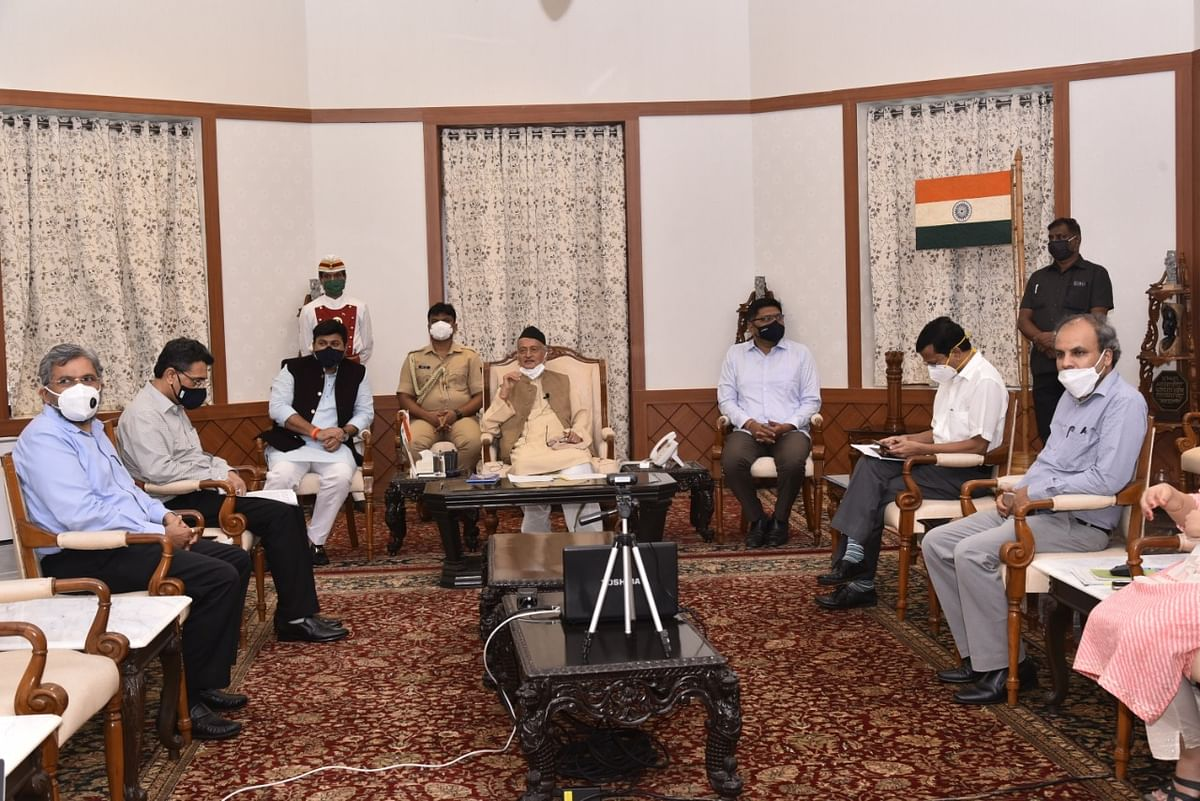 Governor of Maharashtra Bhagat Singh Koshyari (C) conducts a meeting with officials over exams