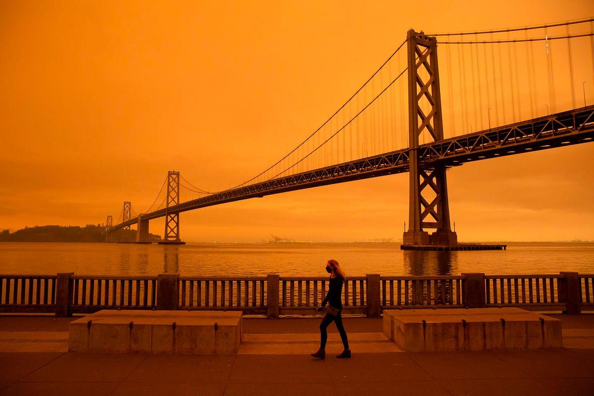 US wakes up to dark clouds, orange sky