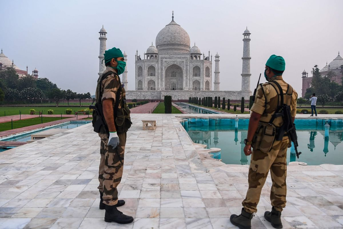 Security personnels patrols at the Taj Mahal in Agra on September 21, 2020. - The Taj Mahal reopens to visitors on September 21 in a symbolic business-as-usual gesture, even as India looks set to overtake the US as the global leader in coronavirus infections.