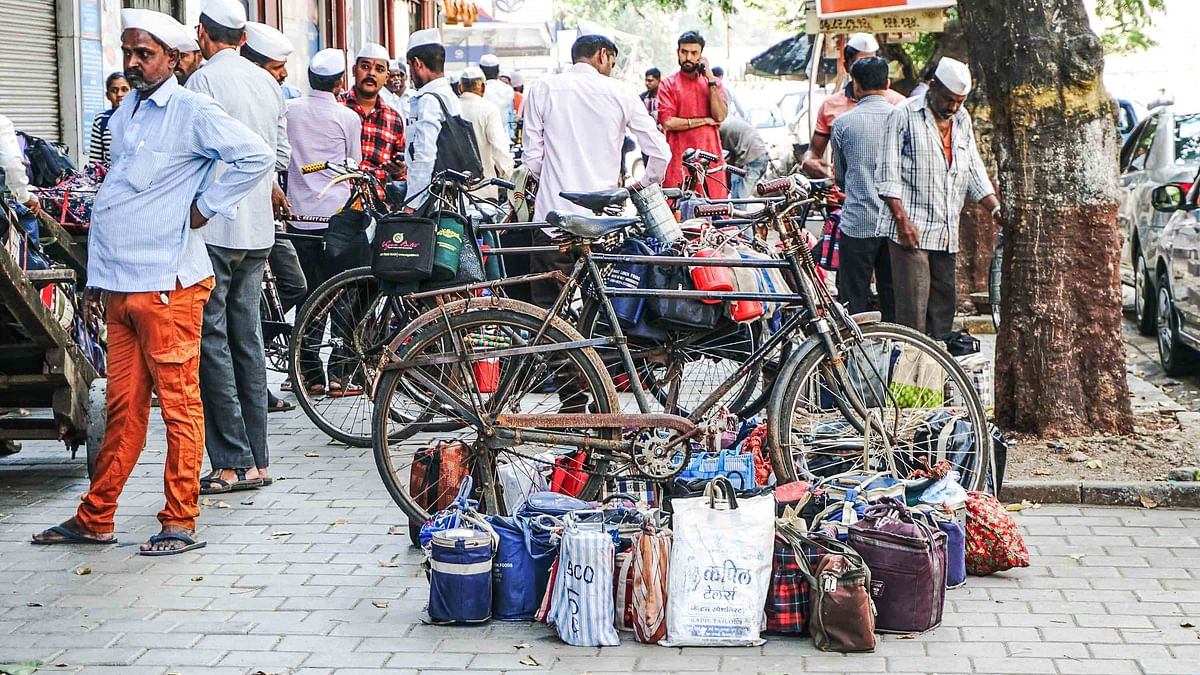 Let us travel in trains to earn our bread, Mumbai's Dabbawalas urge govt