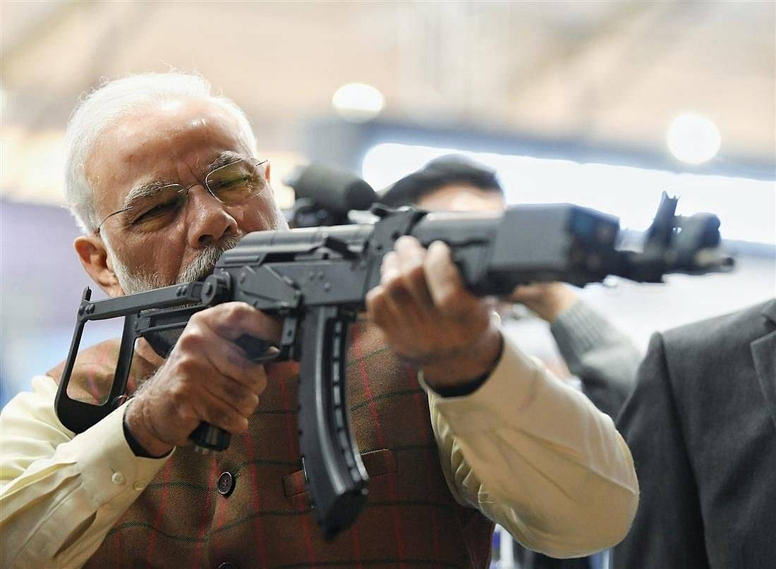 Prime Minister Narendra Modi at a virtual firing range on display at the Defence Expo in February