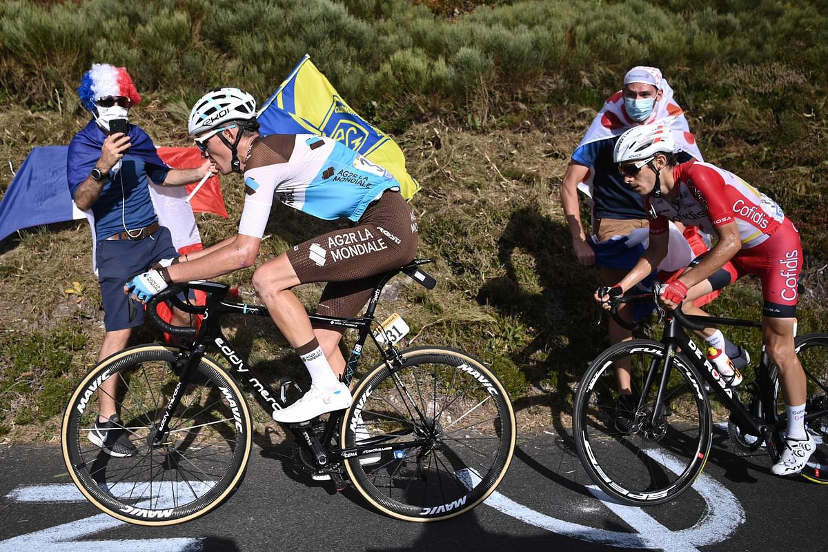 Team AG2R La Mondiale rider France's Romain Bardet (L) and Team Cofidis rider France's Guillaume Martin ride during the 13th stage of the Tour de France cycling race, 191 km between Chatel-Guyon and Puy Mary, on Friday