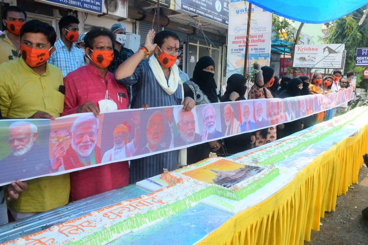 Members of Bharatiya Sindhu Sena cut a 70 feet long cake to celebrate ahead of the Prime Minister Narendra Modis 70th birthday, in Bhopal on Wednesday.