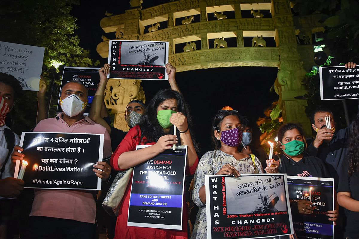 All India Students Federation (AISF) activists hold placards and light candles demanding justice for the Hathras gang-rape victim, in Mumbai, Wednesday, Sept. 30