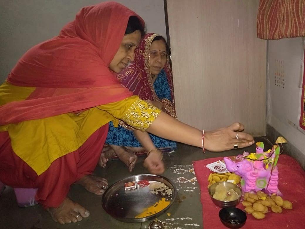 Women worshipping the Gaja Laxmi form of the goddess on the concluding day of 15-day Mahalaxmi Vrat
