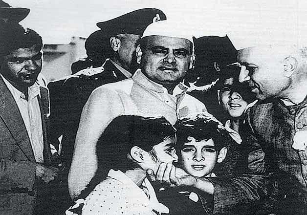 Feroze Gandhi with his son Sanjay Gandhi and Rajiv Gandhi Sharing Light Moments with Pandit Nehru.