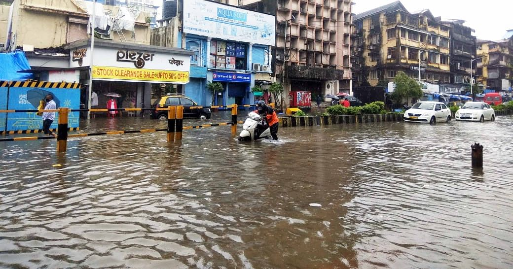 In Pics: Roads waterlogged, vehicles damaged - How Mumbai looked as torrential rains lashed the city