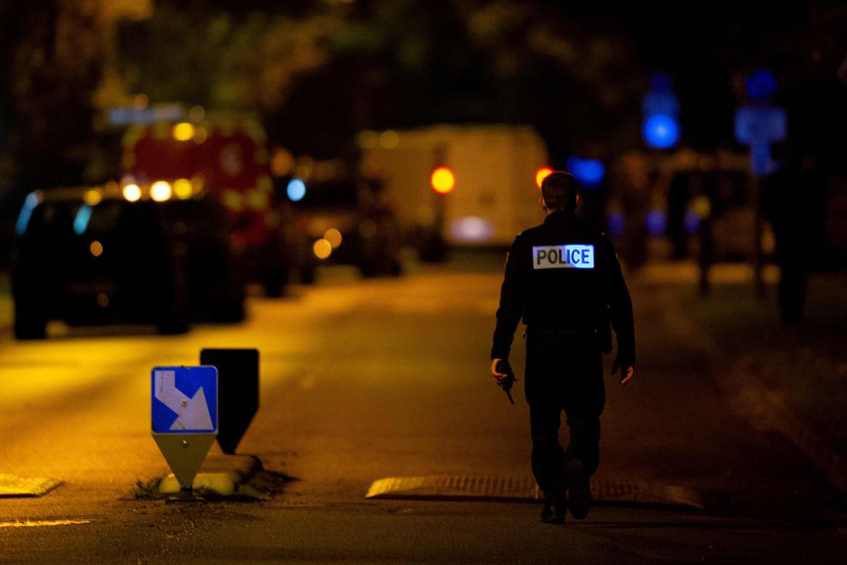 A French police officer stands guard a street in Eragny on October 16, 2020, where an attacker was shot dead by policemen after he decapitated a man earlier on the same day in Conflans-Sainte-Honorine. - French anti-terror prosecutors said Friday they were investigating an assault in which a man was decapitated on the outskirts of Paris and the attacker shot by police. The attack happened at around 5 pm (1500 GMT) near a school in Conflans Saint-Honorine, a western suburb of the French capital. The man who was decapitated was a history teacher who had recently shown caricatures of the Prophet Mohammed in class. French prosecutors are treating the attack as a terror incident, which coincides with the trial of alleged accomplices of the 2015 Charlie Hebdo attackers and comes weeks after a man injured two people he thought worked for the magazine.