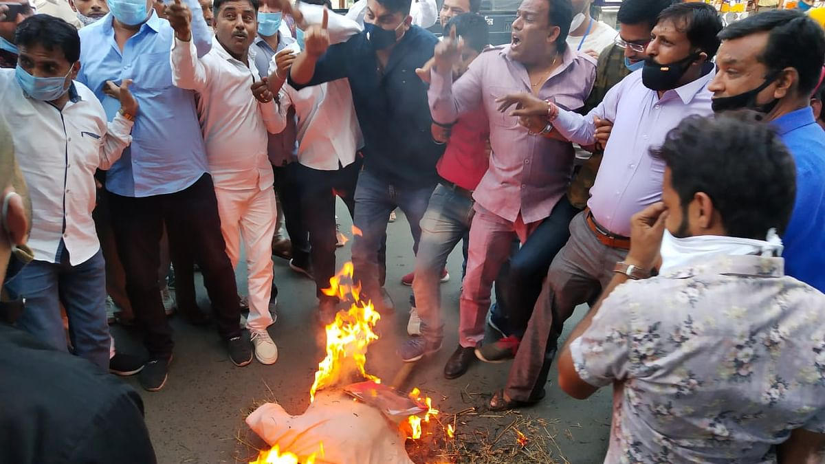 Effigy being burnt by Congress leaders.