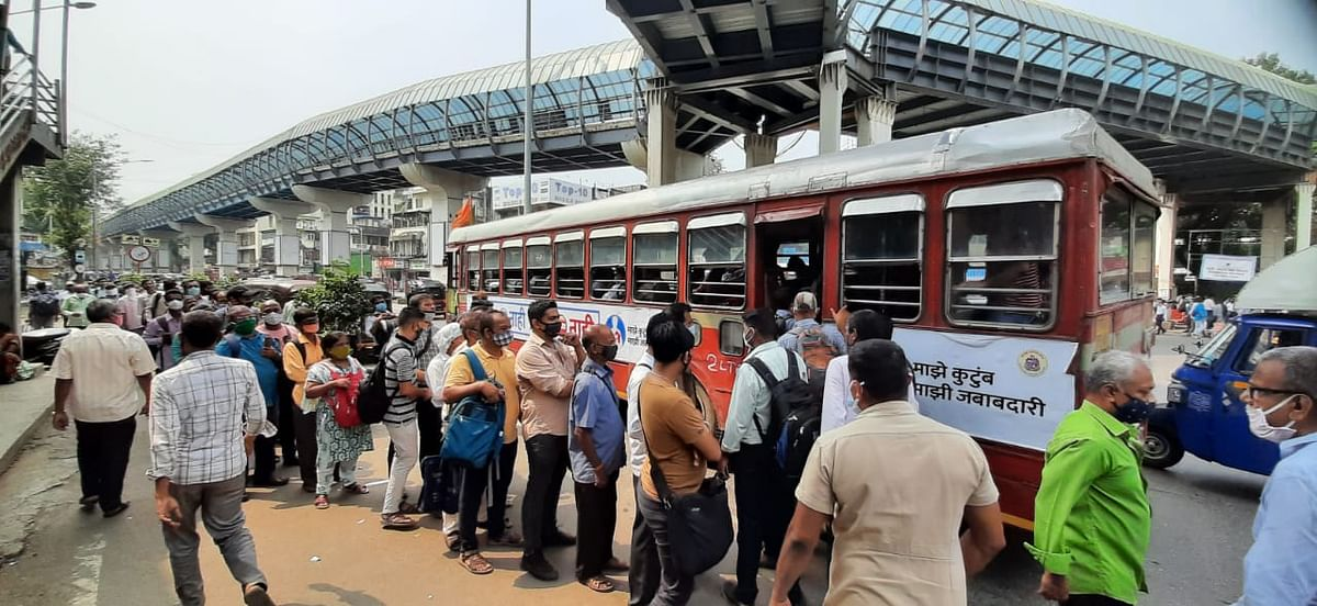Crowd at bus stop after Power supply system halted local trains in Mumbai.
