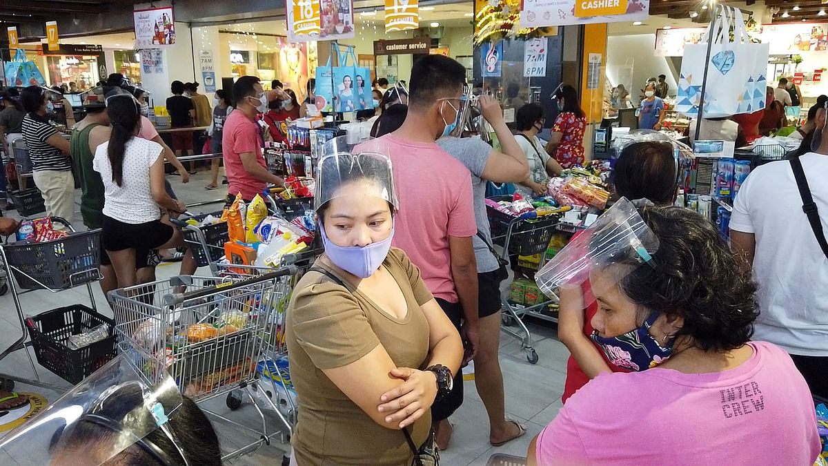 Residents crowd a grocery store to buy essential goods in Legaspi, Albay province, south of Manila ahead of Typhoon Goni