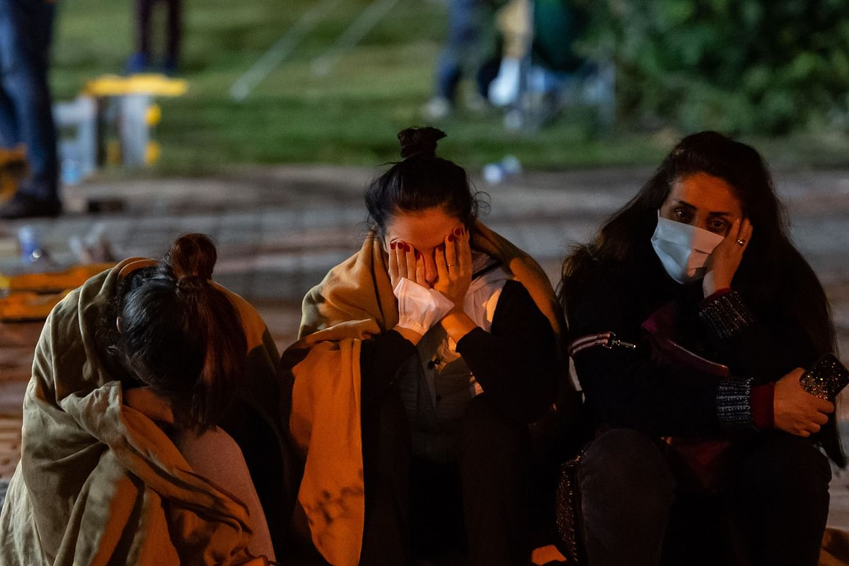 Relatives of potential victims wait as rescuers search for survivors  after a powerful earthquake struck Turkey and parts of Greece.