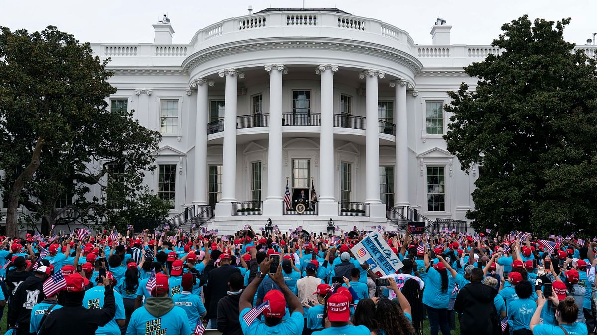 President Donald Trump speaks from the Blue Room Balcony of the White House to a crowd of supporters, Saturday, Oct. 10, 2020, in Washington