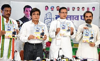 AICC general secretary Randeep Surjewala releases the Congress manifesto with party leader Raj Babbar and others in Patna.
