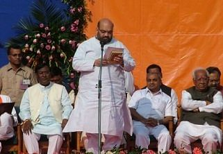 Amit Shah was sworn in as a minister for the first time in 2002.