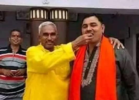 Accused Dhirendra Pratap Singh (R) with local BJP MLA Surendra Singh (C)