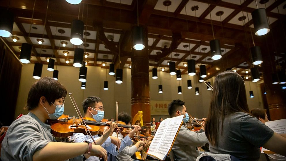 Musicians from the Wuhan Philharmonic Orchestra rehearse a day before their concert to open the Beijing Music Festival.