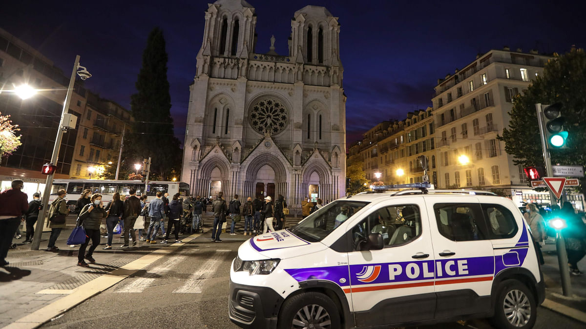 A Police vehicle is parked by the Notre-Dame de l'Assomption Basilica in Nice