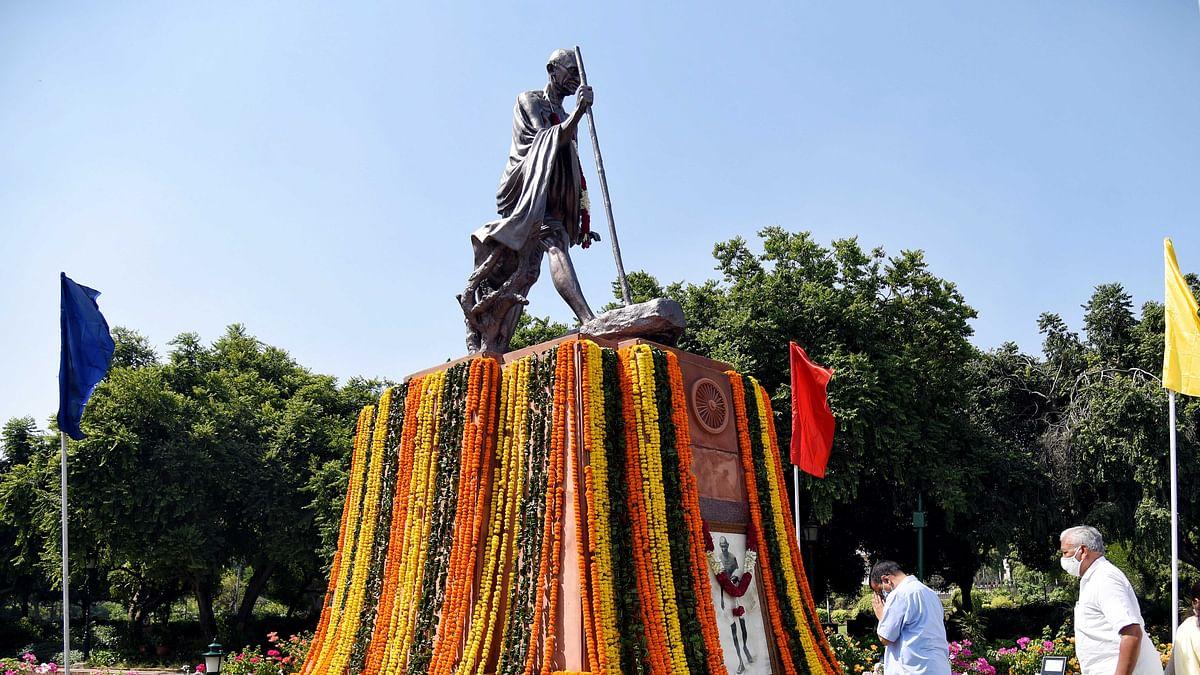 Mumbai: People gather at Gandhi statue to mark birth anniversary