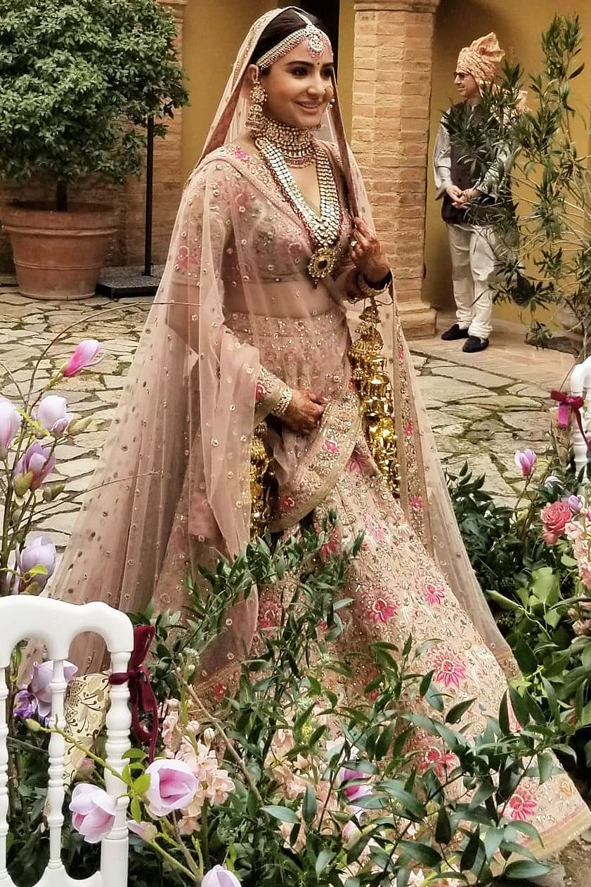 Did Neha Kakkar 'copy' Anushka Sharma's  blush pink wedding ensemble by Sabyasachi?