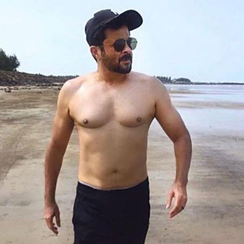 Anil Kapoor's 'topless' picture on the beach is making netizens go weak in the knees