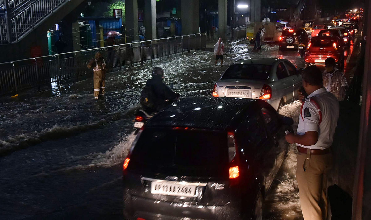 Watch: Man swept away, cars damaged as torrential rain batters Hyderabad