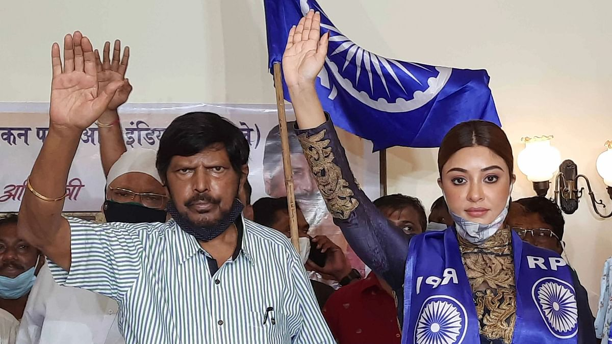 Actor Payal Ghosh with Union Minister Ramdas Athawale as she joins his RPI (A), in Mumbai yesterday.