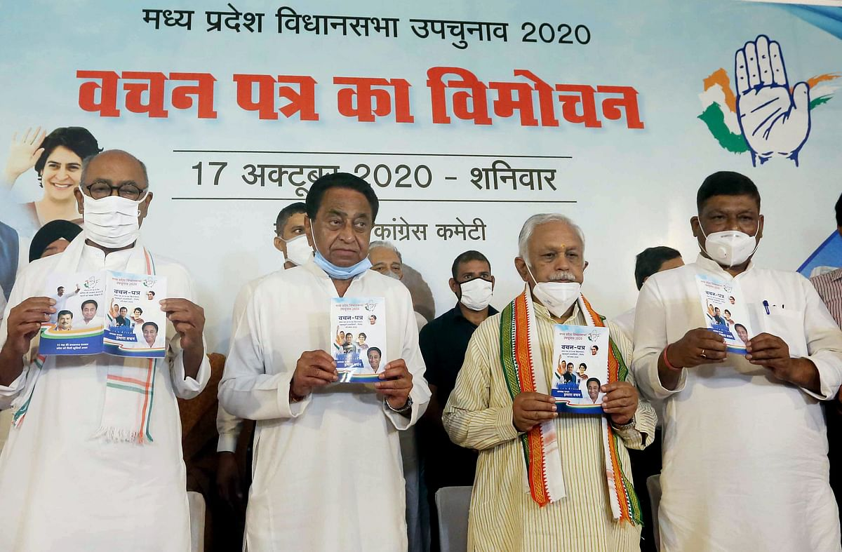 Madhya Pradesh State Congress President Kamal Nath along with Rajya Sabha MP Digvijay Singh and other leaders releases the partys Vachan Patra ahead of the by-elections in the State, at his residence in Bhopal on Saturday.