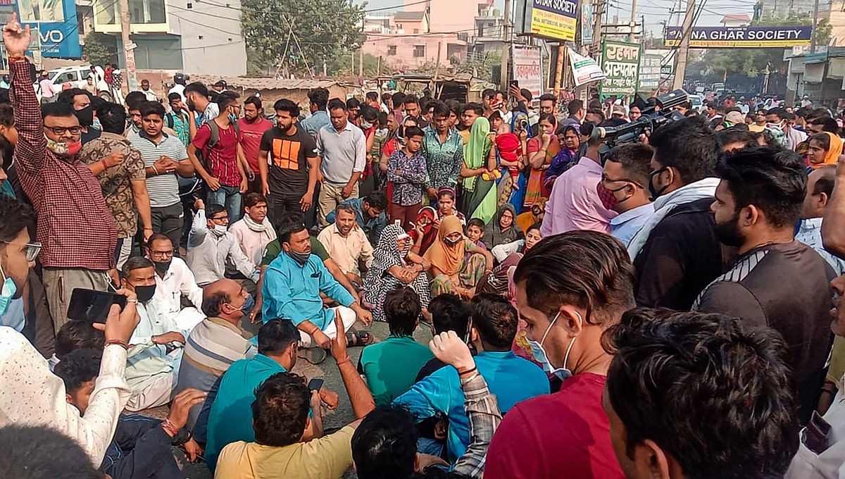 People block Ballabhgarh-Sohna road during a protest, demanding justice for Nikita Tomar