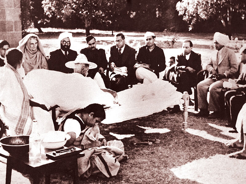 Gandhi in Birla House with members of new government