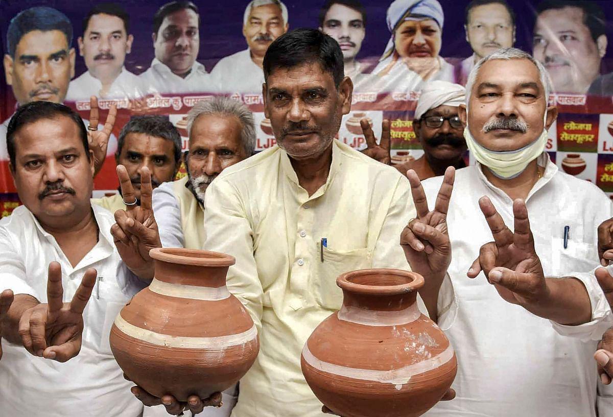 Lok Janshkti Party (S) president Satyananad Sharma displays earthen pot, the new symbol of his party, ahead of Bihar polls, in Patna.