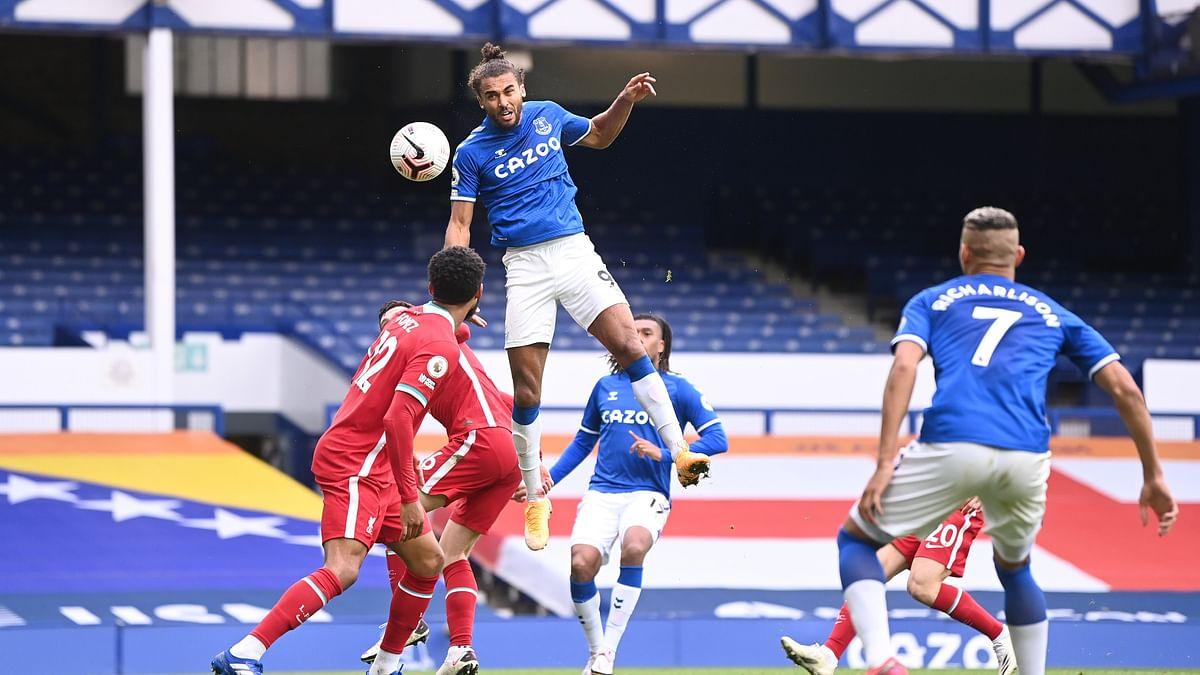 Everton's Dominic Calvert-Lewin (C) heads the ball
