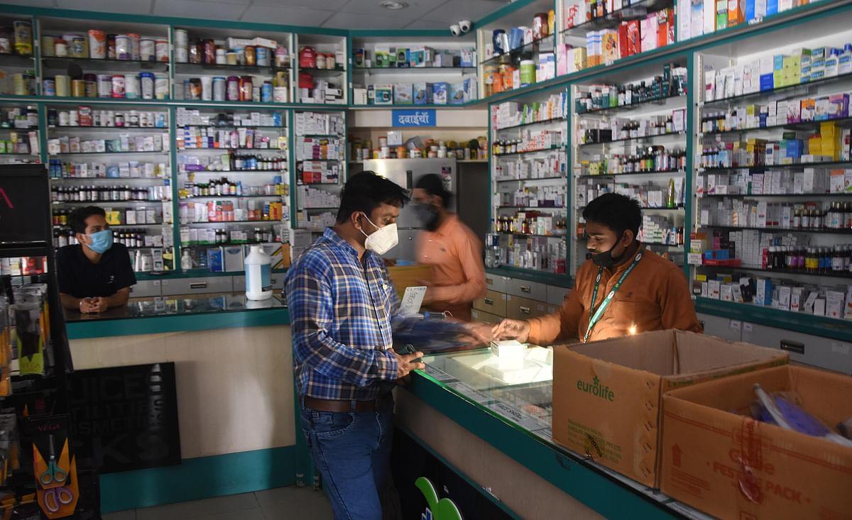 Mumbai: Medical shop employee using emergency light during the power failure in Mumbai, Monday, Oct 12, 2020.