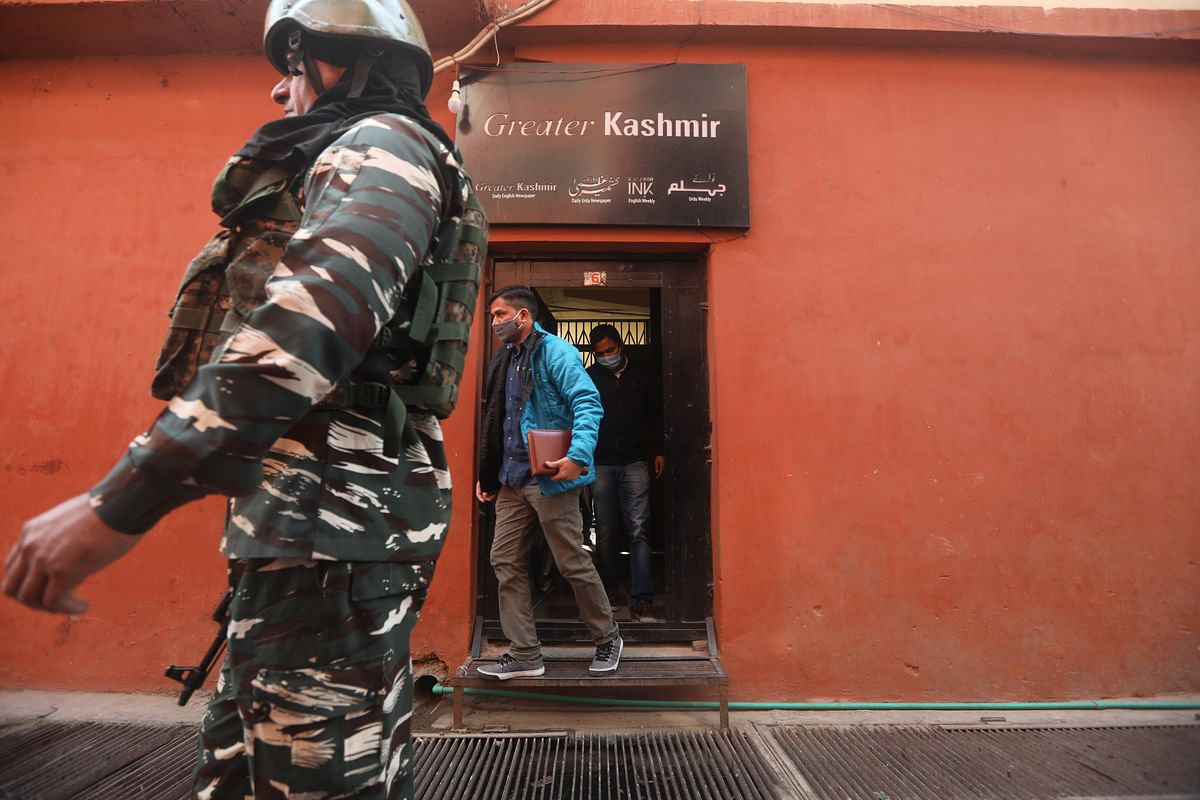 NIAofficers leave the office of Greater Kashmir, a leading newspaper in Srinagar, on Wednesday