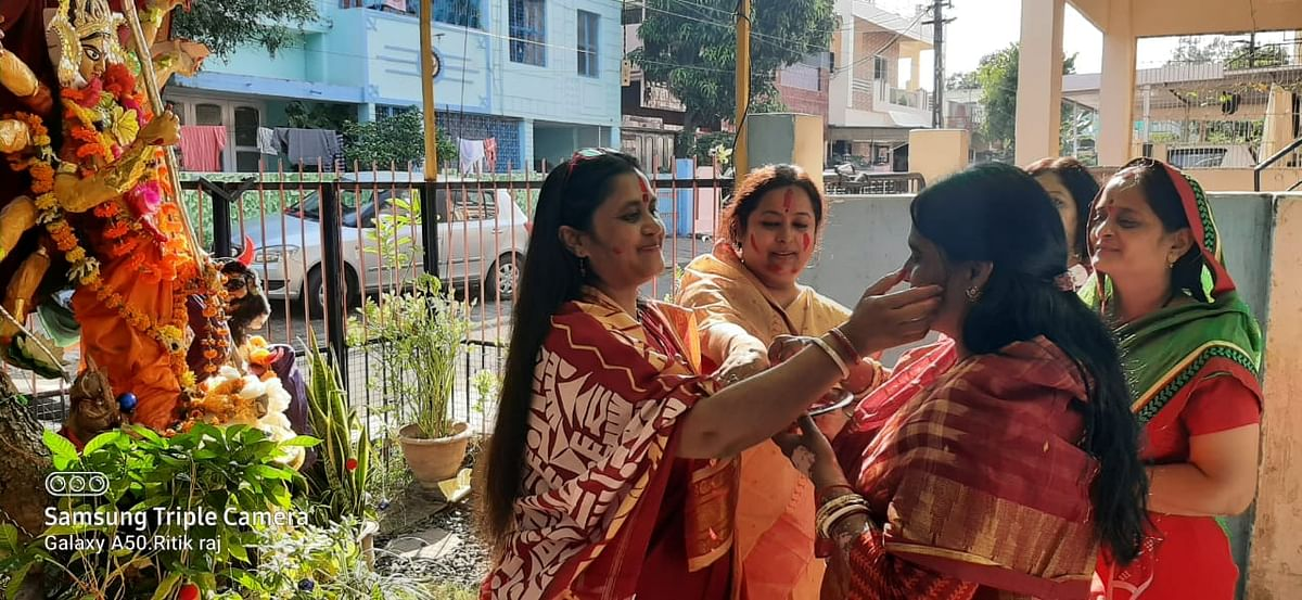 Social activist Shibani Ghosh applying vermilion  on  one another in Sector I, Shakti Nagar in the city on Monday