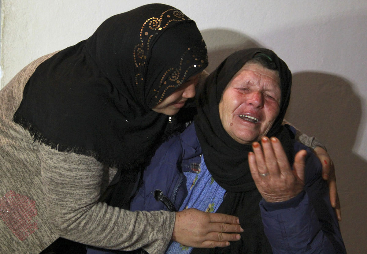 Mother of Nice assailant Brahim Aouissaoui, who killed three people and wounded several in the French city of Nice, cries at her home.