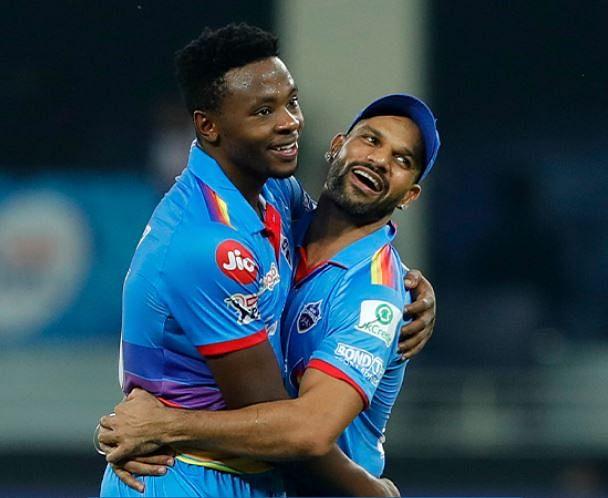 Delhi Capitals batsman Shikhar Dhawan and Kagiso Rabada during their match against Royal Challengers Bangalore. Rabada webnt on to claim four wickets, at Dubai International Cricket Stadium, in Dubai, Monday,