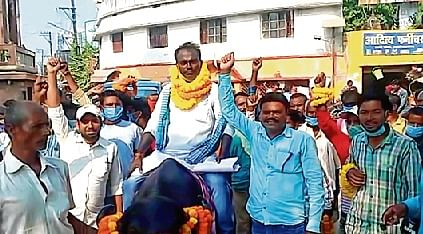 Nachari Mandal from Bahadurpur assembly constituency rides a buffalo while going to file nomination papers, in Darbhanga.