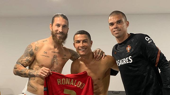 Sergio Ramos (L), Cristiano Ronaldo (C) and Pepe