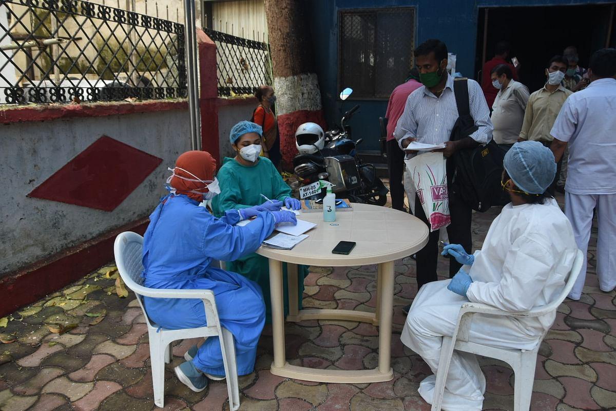 Mumbai: Members of Doctor's team arrange alternative OPD outside Babu Jagjivanram Hospital at Mumbai central due to power failure on Monday.