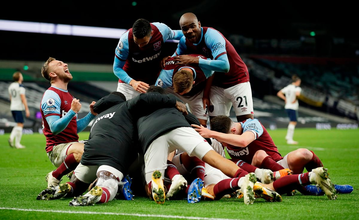 West Ham players celebrate after West Ham United's Argentinian midfielder Manuel Lanzini (unseen) scored their third goal during the English Premier League against Tottenham Hotspur, at Tottenham Hotspur Stadium in London on Sunday